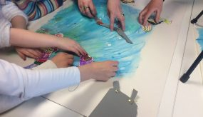 children learning about fish in the river through creative activities
