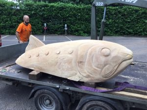 shad carving play sculpture on lorry