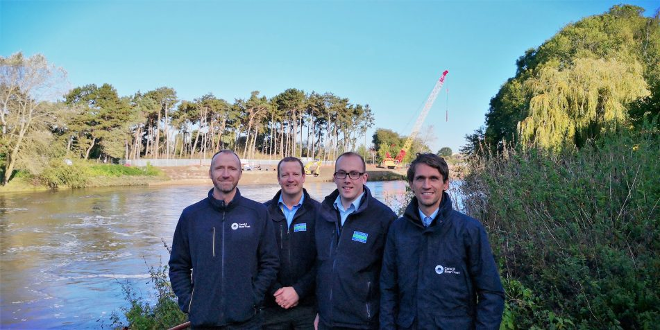 Staff from Unlocking the Severn and Severn Trent overlooking works at Diglis Weir