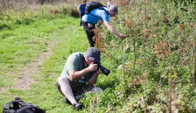 workshop participants photograph nature by the riverside