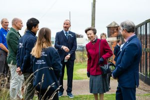 HRH The Princess Royal talking to Diglis Island Guide volunteers at the weir viewing point on Diglis Island